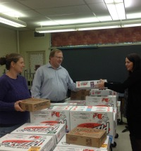 Volunteer parents handing out Little Caesar's Pizza Kits.