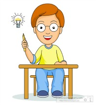 Student at desk with an idea.